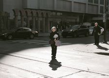 Woman Crossing The Street royalty free stock photo