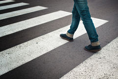 Woman crossing street Stock Image