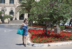 Woman crossing street in Malta stock images