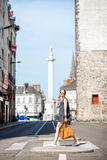 Woman crossing the street in the old city. Beautiful woman crossing the street at the old town of Nantes city in France Stock Photos