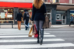 Woman crossing the street at the pedestrian crossing Royalty Free Stock Image