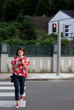 Woman crossing the street on red light Royalty Free Stock Photos