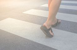 A woman crossing. A crosswalk stock photo