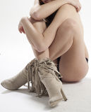 Woman crouched on floor Stock Image