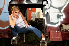 Woman crouching inside truck royalty free stock photo
