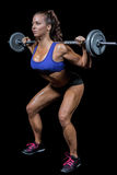 Woman crouching while lifting crossfit Stock Photography