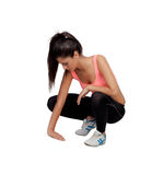 Woman crouching in their training. Isolated on white background Stock Image