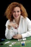 Woman croupier at the green table Royalty Free Stock Photos