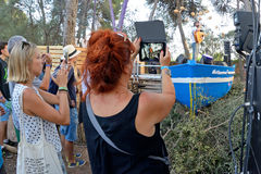 A woman from the crowd recording a concert with her tablet at Vida Festival Royalty Free Stock Photography