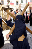 Woman & crucifix, Easter procession in Spain Royalty Free Stock Images