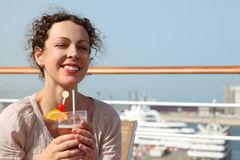 Woman on cruise liner with cocktail Stock Photos