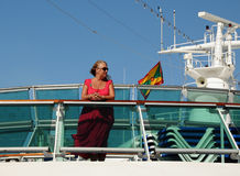 Woman on a Cruise Ship. Middle-aged woman on the top deck of a cruise ship Royalty Free Stock Photography