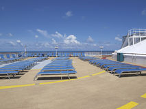Woman on cruise ship deck. Lone woman tanning alone on cruise ship deck with beautiful blue sky Royalty Free Stock Images