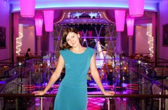 Woman cruising onboard Oasis of the Seas. Young caucasian woman in the disco lounge of Royal caribbean owned cruise ship Oasis of the Seas Stock Photos
