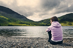 Woman by Crummock Water, Lake District. Stock Photo