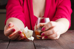 Woman crumpled paper note. And drink alcohol royalty free stock images