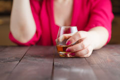 Woman crumpled paper note. And drink alcohol stock images