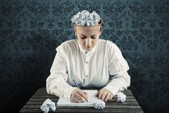 Woman with a crumpled paper in top of his head and writing on paper Royalty Free Stock Photography