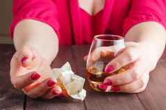 Woman crush paper note and drink. Alcohol royalty free stock images