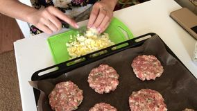 Woman crushes boiled chicken eggs. Minced meat steaks with potatoes, eggs and cheese. Cooking steps and ingredients. Woman crushes boiled chicken eggs. Minced stock video footage