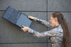 Woman crushing laptop Stock Photo
