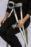 Woman with Crutches Stock Photos