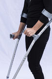 Woman with Crutches Stock Images