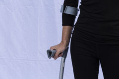 Woman with Crutches Royalty Free Stock Images