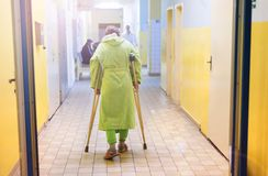 Woman with crutches royalty free stock photos