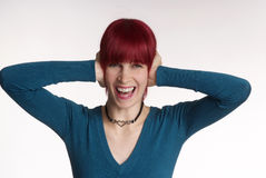 Woman cry. Woman with red hair keeps ear closed Stock Photo