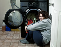 Woman Crying. In her laundry room after being abused Stock Images