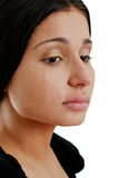 Woman crying. Hispanic woman crying on a white background Royalty Free Stock Images