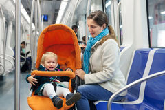 Woman with crying child  at subway Stock Photography