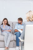 Woman crying on the couch Stock Photo