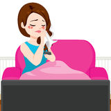 Woman Crying Couch TV. Young woman crying while watching TV movie lying on couch with blanket Stock Image