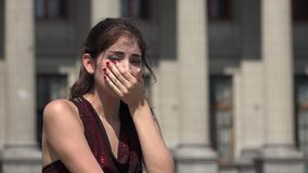 Woman crying at courthouse or library. A young hispanic adult female stock footage
