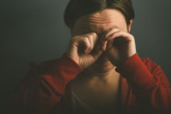 Woman crying in despair Stock Image