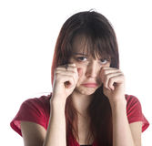 Woman in Crying Gesture with Hands on her Face. Close up Young Woman Showing Crying Gesture with Hands on her Face While Looking at the Camera So Sad, Isolated Royalty Free Stock Photography