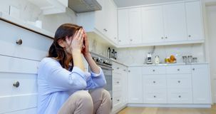 Woman crying in kitchen at home 4k. Depressed woman crying in kitchen at home 4k stock footage