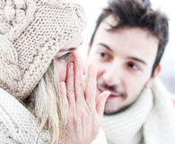 Woman crying near man in winter Royalty Free Stock Photo