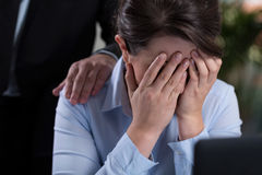 Woman crying in the office Stock Image