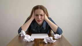 Woman crying over a blank sheet. Of paper stock video footage