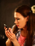 Woman crying by phone. Girl talking on phone . Royalty Free Stock Photos