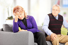 Woman crying after quarrel with her angry husband at home Stock Photos