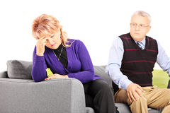 Woman crying after quarrel with her angry husband Stock Photography