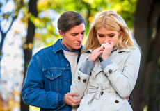 Woman crying after Quarreling With Man. Betrayal and forgiveness couple. Girl is crying with handkerchief on outdoor stock images