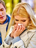 Woman crying after Quarreling With Man. Betrayal and forgiveness couple. Girl is crying with handkerchief on outdoor. Man console woman royalty free stock photography