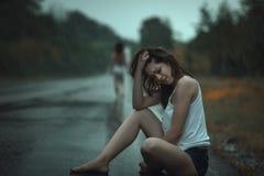 Woman crying in the rain. Stock Photo