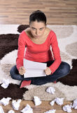 Woman Crying, Reading Letter. Unhappy young woman crying, reading Letter royalty free stock photo