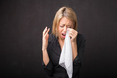 Woman crying and wiping  her tears in tissue Royalty Free Stock Image